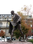 Statue of Mahatma Gandhi walking installed adjacent to Embassy Row -  Massachusetts Ave. NW near Dupont Circle, Washington DC. Image © L Peat O'Neil 2009